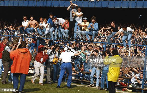 Derby County Manager Arthur Cox celebrates promotion with fans after a Today League Division Two match against Plymouth at the Baseball Ground in...
