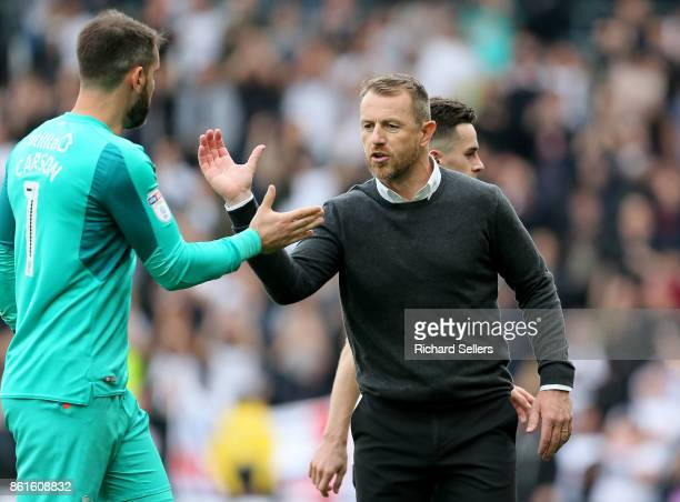 Derby County manager Gary Rowett and Derby County's Scott Carson after the Sky Bet Championship match between Derby County and Nottingham Forest at...