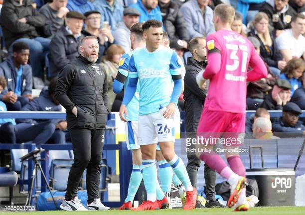 Derby County manager Wayne Rooney issues instructions to his side during a first half break in play during the Sky Bet Championship match between...