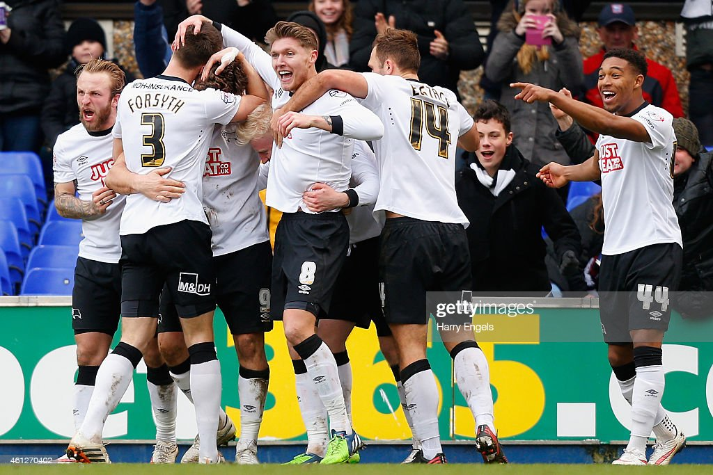 Derby County players celebrate after Chris Martin scored during the Sky Bet Championship match between Ipswich Town and Derby County at Portman Road on January 10, 2015 in Ipswich, England.