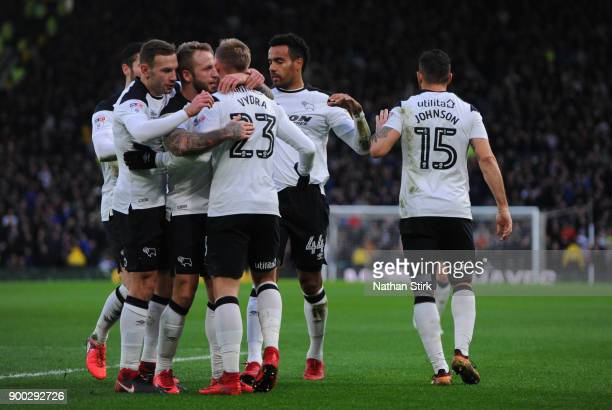 Derby County players celebrate after Matej Vydra scores during the Sky Bet Championship match between Derby County and Sheffield United at iPro...