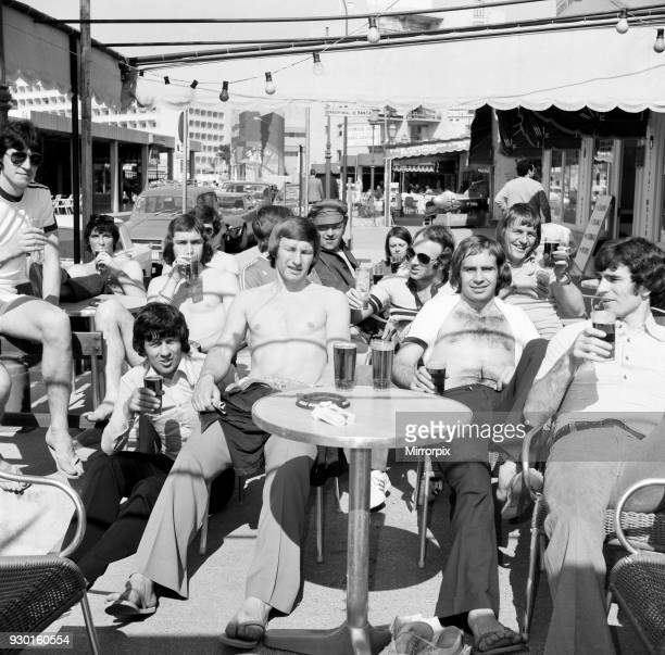 Derby County players in Majorca as they celebrate their League Titile win. Having a few pints in the Red Lion in Magaluf, 29th April 1975.