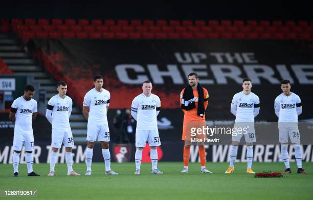 Derby County players observe a minutes silence in memory of former England player Nobby Stiles MBE and to mark Armistice Day prior to the Sky Bet...
