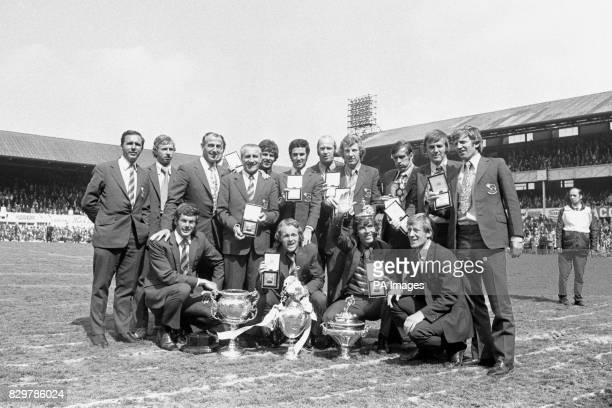 Derby County players show off their League Championship medals aas they pose with the trophies won by the club during the 197172 season John McGovern...