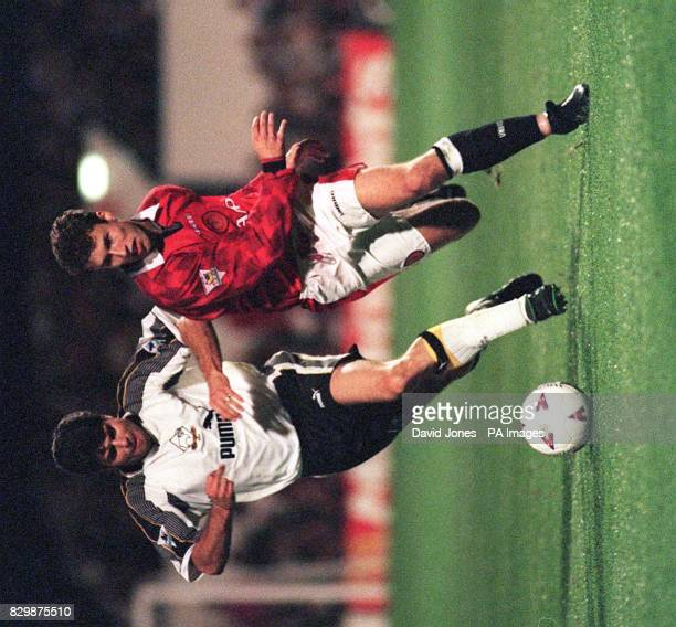 Derby County's Aljosa Asanovic and Manchester United's Ronny Johnsen chase the ball during tonight's Premiership match at the Baseball Ground Picture...