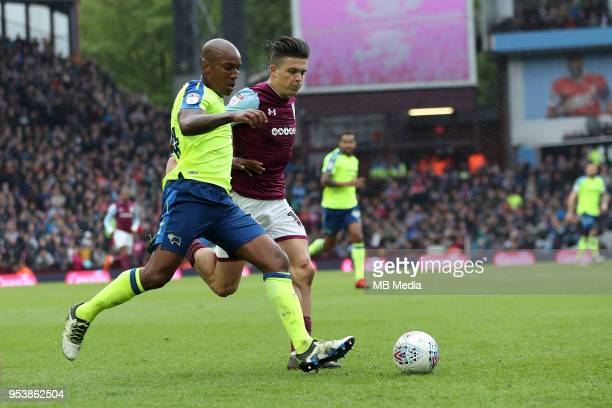 Aston Villa v Derby County Sky Bet ChampionshipnBIRMINGHAM ENGLAND APRIL 28 derby County's Andre Wisdom and Aston Villa's Jack Grealish in a chase...
