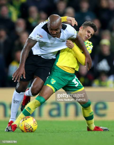 Derby County's Andre Wisdom and Norwich City's Max Aarons battle for the ball during the Sky Bet Championship match at Carrow Road Norwich City v...