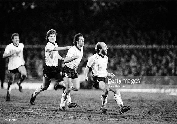 Derby County's Archie Gemmill celebrates after scoring the first goal as Gary Mills and Brian Attley run to congratulate him during their FA Cup 3rd...