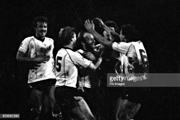 Derby County's Archie Gemmill is congratulated by his jubilant teammates after scoring the opening goal from a free kick