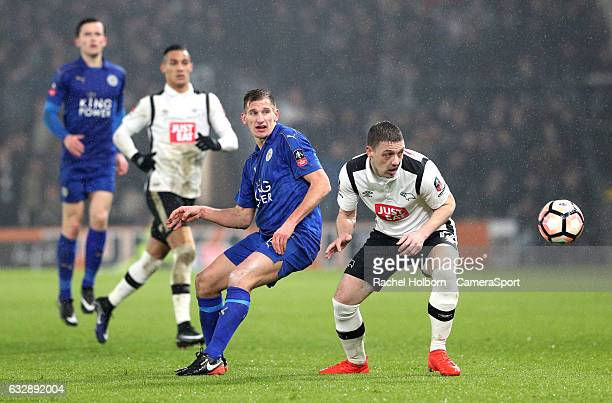 Derby County's Chris Baird and Leicester City's Marc Albrighton during the Emirates FA Cup Fourth Round match between Derby County and Leicester City...
