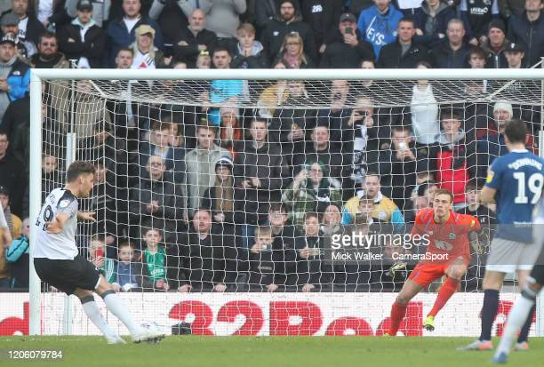 Derby County's Chris Martin scores his sides third goal beating Blackburn Rovers Christian Walton during the Sky Bet Championship match between Derby...