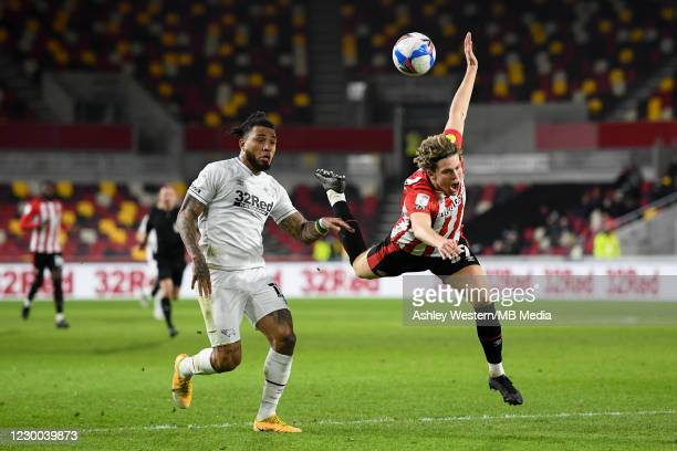 Derby County's Colin Kazim-Richards battles with Brentford's Mads Bech Sorensen during the Sky Bet Championship match between Brentford and Derby...