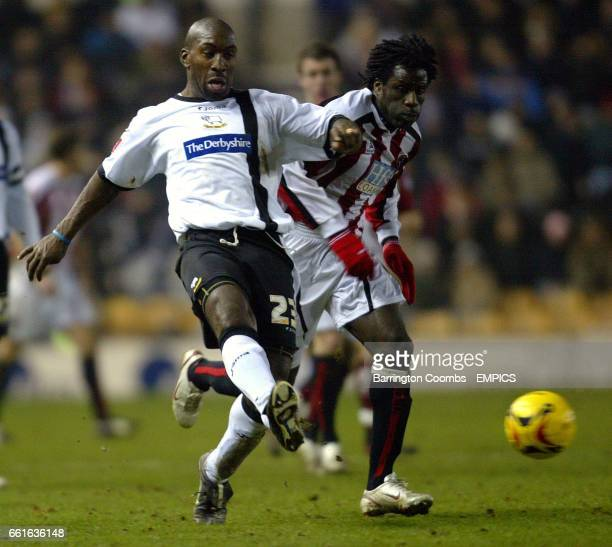 Derby County's Darren Moore and Sheffield United's Ade Akinbiyi battle for the ball