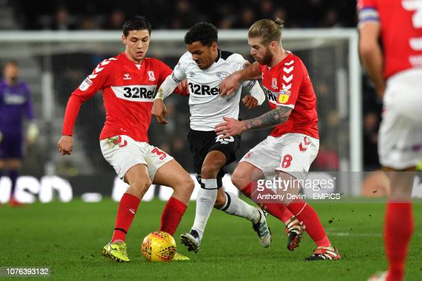 Derby County's Duane Holmes is tackled by Middlesbrough's Mo Besic and Adam Clayton Derby County v Middlesbrough Sky Bet Championship Pride Park