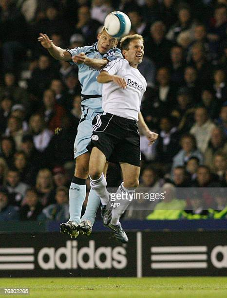 Derby County's Eddie Lewis and Newcastle United's Alan Smith in their Premiership League clash at Pride Park stadium in Derby United Kingdom 17...