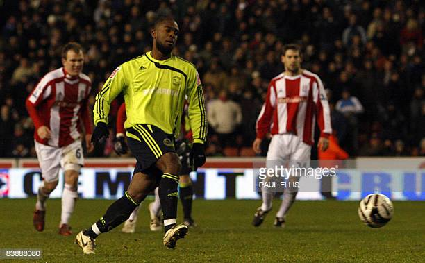 Derby County's English forward Nathan Ellington scores from a penalty in the closing stages against Stoke City during their English League Cup...