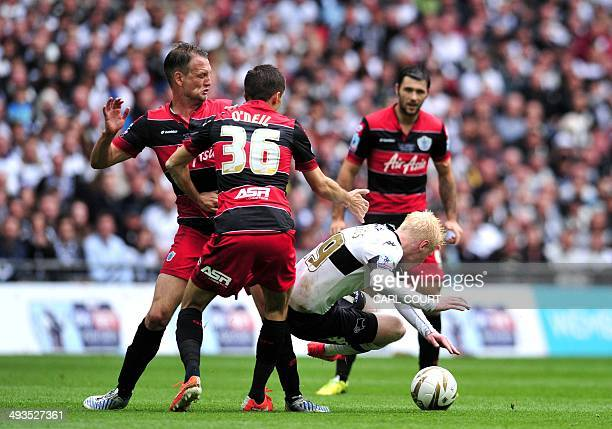 Derby County's English striker Chris Martin falls to the grond as he views with QPR's English midfielder Gary O'Neil during the English Championship...