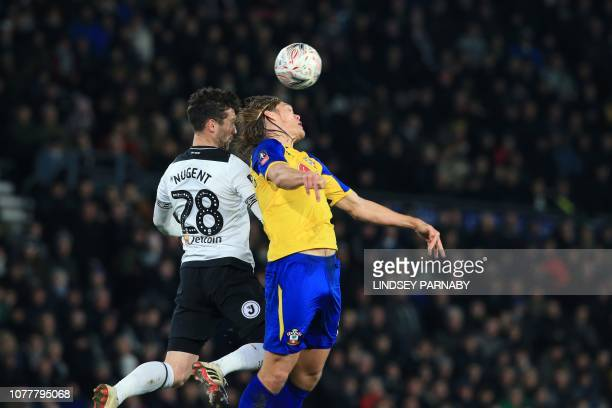 Derby County's English striker David Nugent vies with Southampton's Danish defender Jannik Vestergaard during the English FA Cup third round football...