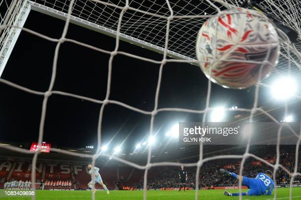 Derby County's Englishborn Irish defender Richard Keogh turns to celebrate after scoring the winning penalty in the shootout during the English FA...