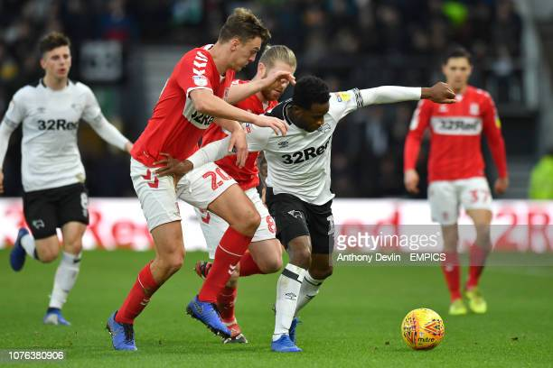 Derby County's Florian Jozefzoon is tackled by Middlesbrough's Dael Fry and Adam Clayton Derby County v Middlesbrough Sky Bet Championship Pride Park