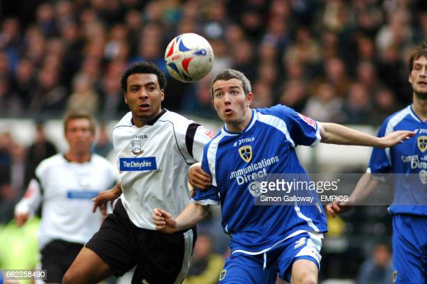 Derby County's Giles Barnes and Cardiff City's Kevin McNaughton in action