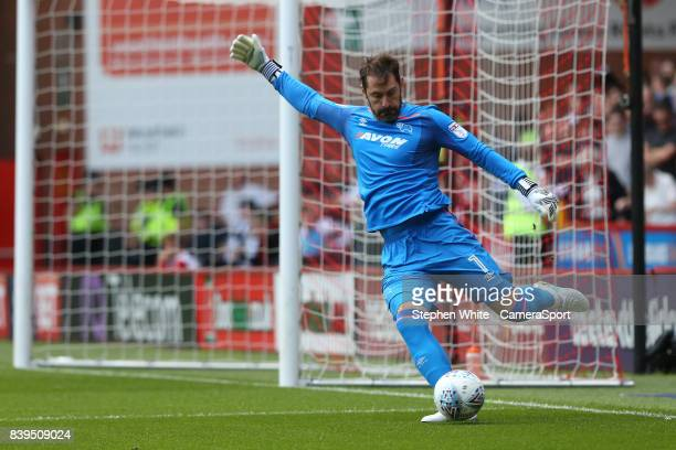 Derby County's goalkeeper Scott Carson makes the poor clearance which lead to Sheffield United's Billy Sharp scoring the opening goal during the Sky...