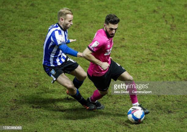 Derby County's Graeme Shinnie shields the ball from Sheffield Wednesday's Barry Bannan during the Sky Bet Championship match between Sheffield...