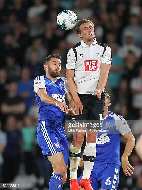 Derby County's James Wilson jumps with Ipswich Town's Jonathan Douglas during the Sky Bet Championship match between Derby County and Ipswich Town at...