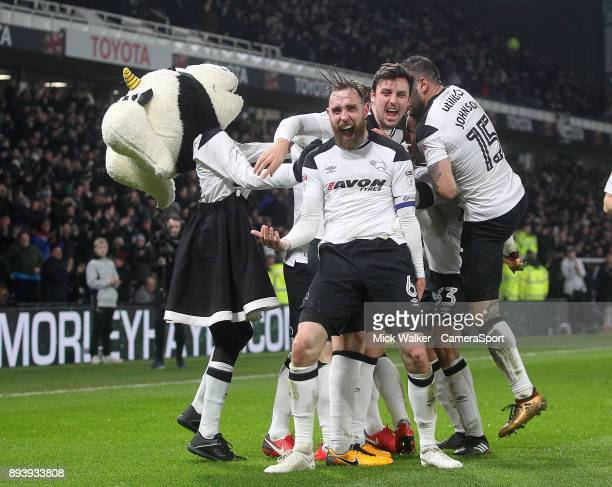 Derby County's Johnny Russell celebrates scoring his sides second goal with his team mates during the Sky Bet Championship match between Derby County...