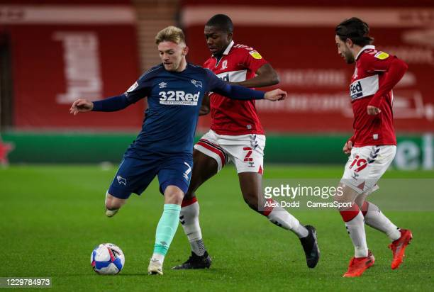 Derby County's Kamil Jozwiak shields the ball from Middlesbrough's Anfernee Dijksteel during the Sky Bet Championship match between Middlesbrough and...