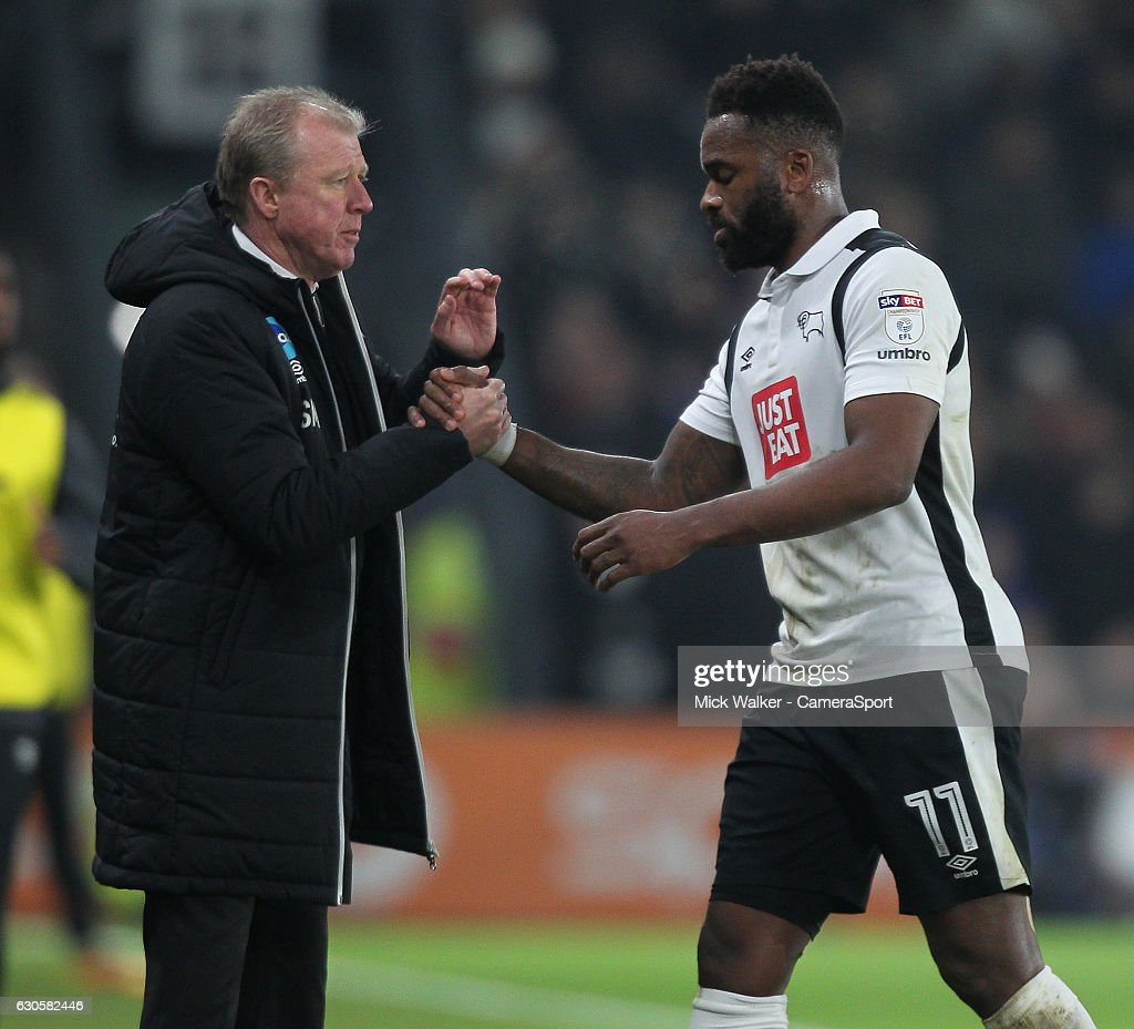 Derby County's Manager Steve McClaren congratulates Darren Bent during the Sky Bet Championship match between Derby County and Birmingham City at iPro Stadium on December 27, 2016 in Derby, England.
