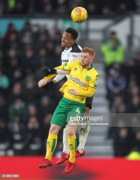 Derby County's Marcus Olsson jumps with Norwich City's Harrison Reed during the Sky Bet Championship match between Derby County and Norwich City at...
