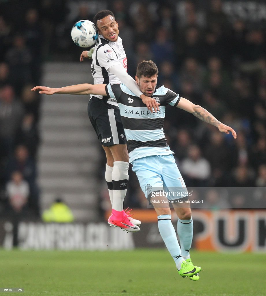 Derby County's Marcus Olsson jumps with Queens Park Rangers' Pawel Wszolek during the Sky Bet Championship match between Derby County and Queens Park Rangers at iPro Stadium on March 31, 2017 in Derby, England.