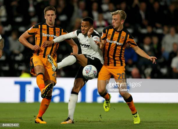 Derby County's Marcus OlssonHull City's Jarrod Bowen and Hull City's Markus Henriksen challenge during the Sky Bet Championship match between Derby...