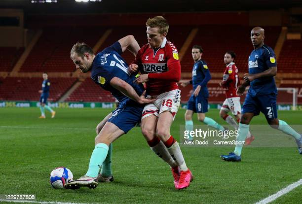 Derby County's Matthew Clarke shields the ball from Middlesbroughs Duncan Watmore during the Sky Bet Championship match between Middlesbrough and...
