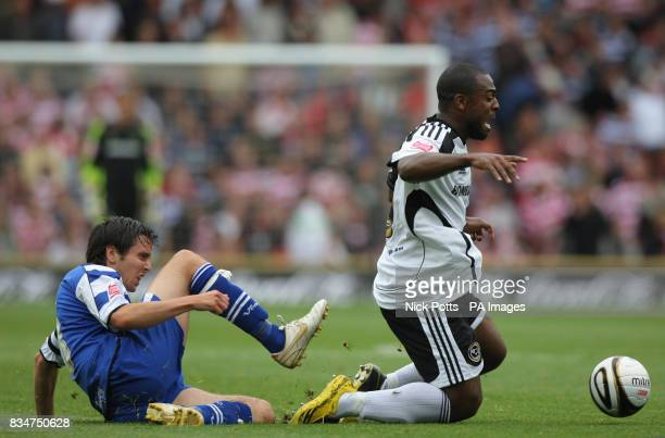 Derby County's Nathan Ellington is challenged for the ball by Doncaster Rovers' Brian Stock during the CocaCola Football Championship match at Pride...