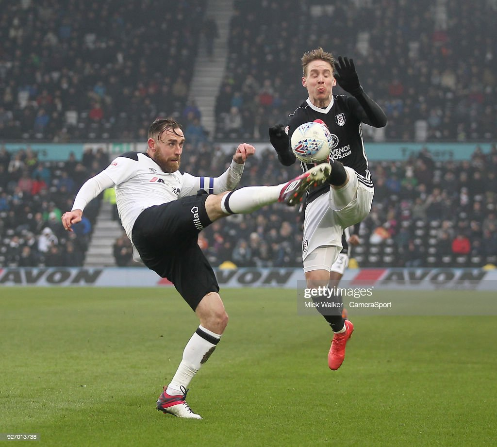 Derby County's Richard Keogh in action with Fulham's Stefan Johansen during the Sky Bet Championship match between Derby County and Fulham at iPro Stadium on March 3, 2018 in Derby, England.