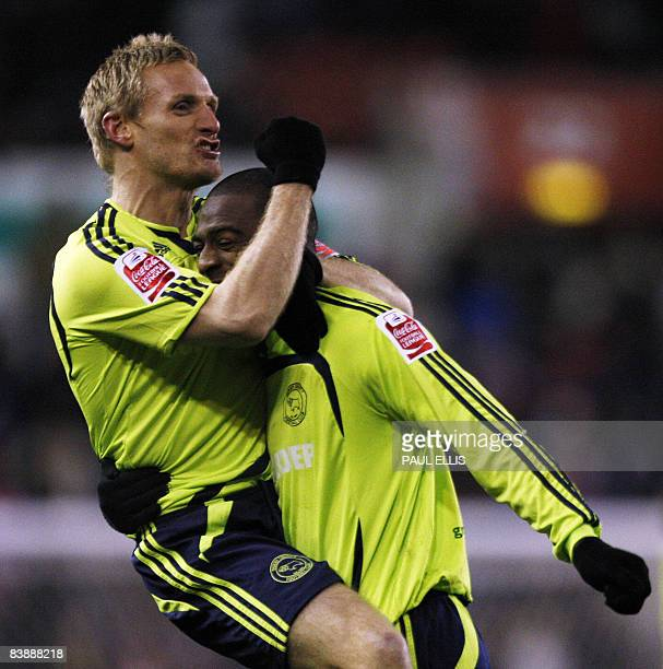 Derby County's Scottish midfielder Gary Teale celebrates with goal-scorer English forward Nathan Ellington after he scored against Stoke City during...