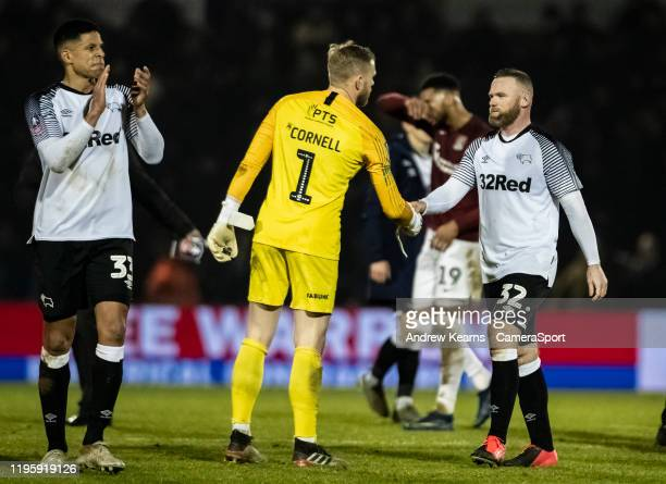 Derby County's Wayne Rooney shakes hands with Northampton Town's goalkeeper David Cornell at the end of the match during the FA Cup Fourth Round...