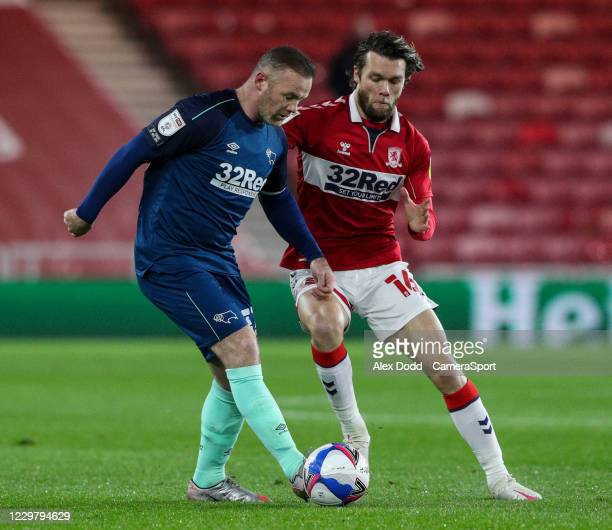 Derby County's Wayne Rooney shields the ball from Middlesbrough's Jonathan Howson during the Sky Bet Championship match between Middlesbrough and...