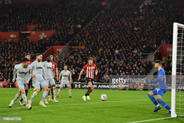 Derby County's Welsh midfielder Harry Wilson's freekick goes straight in past Southampton's English goalkeeper Angus Gunn to make the score 21 during...