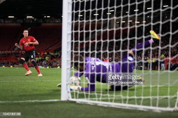 Derby goalkeeper Scott Carson saves the decisive penalty from Phil Jones of Man Utd during the Carabao Cup Third Round match between Manchester...
