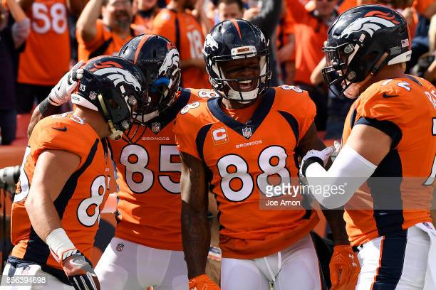 J Derby of the Denver Broncos celebrates his touchdown pass against the Oakland Raiders with teammates Virgil Green Demaryius Thomas and Garett...