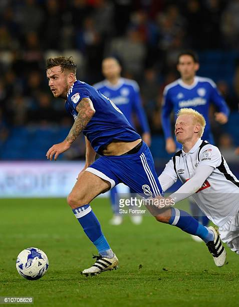 Derby player Will Hughes attempts to challenge Joe Ralls of Cardiff compete for a ball during the Sky Bet Championship match between Cardiff City and...