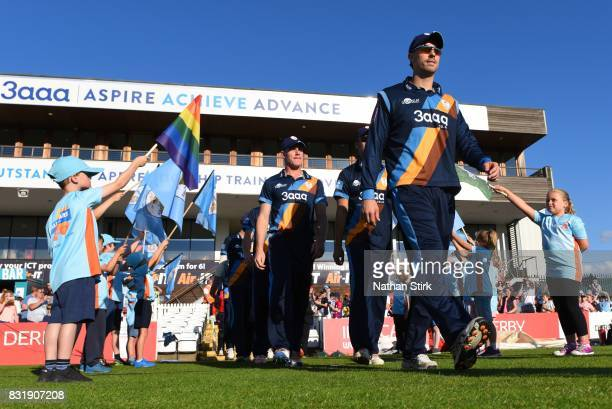 Derby players walk to pitch before the NatWest T20 Blast match between Derbyshire Falcons and Durham Jets at The 3aaa County Ground on August 15 2017...