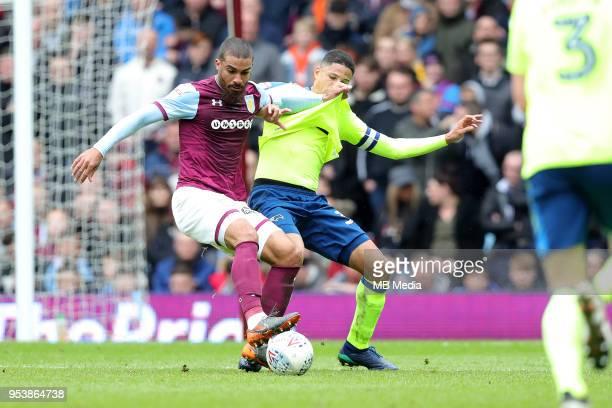 Aston Villa v Derby County Sky Bet Championship'nBIRMINGHAM ENGLAND APRIL 28 Derby's Curtis Davies has his shirt pulled by Aston Villa's Lewis Grabban