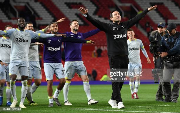 Derby's English manager Frank Lampard celebrates with his players after winning the English League Cup third round football match between Manchester...