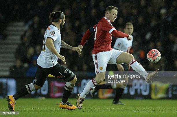 Derby's English midfielder Bradley Johnson vies with Manchester United's English striker Wayne Rooney during the FA cup fourth round football match...