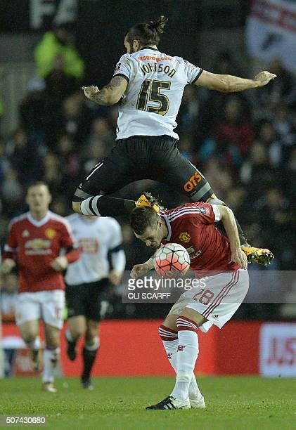 Derby's English midfielder Bradley Johnson vies with Manchester United's French midfielder Morgan Schneiderlin during the FA cup fourth round...