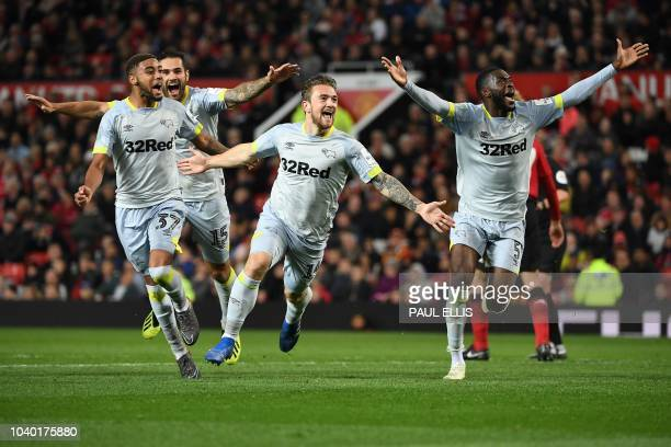 TOPSHOT Derby's English striker Jack Marriott celebrates scoring his team's second goal during the English League Cup third round football match...